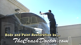 painting top of 35 foot motorhome at southern california's best motorhome and rv repair and paint restoration center www.thecrashdoctor.com